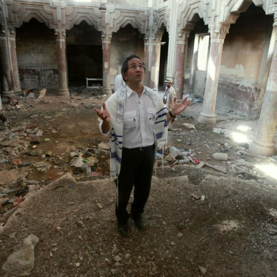 Libyan Jew David Gerbi prays inside the Dar Bishi synagogue in Tripoli, Libya.